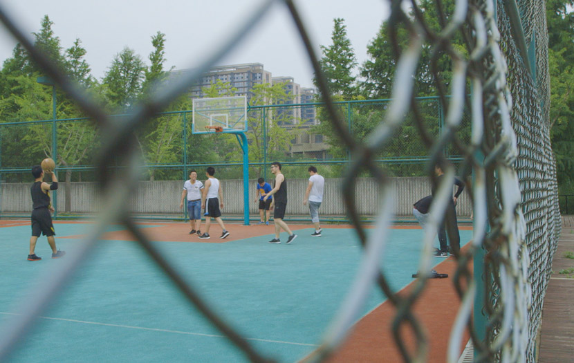Staff and clients play basketball during exercise time at Si Guoqi Gambling Addiction Rehab Center in Shanghai, July 1, 2017. Daniel Holmes/Sixth Tone