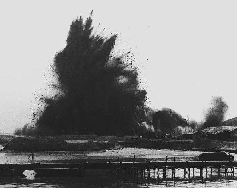 The first explosion before further construction in the Shekou area of Shenzhen, Guangdong province, July 1979. The blast marked the beginning of China's reform and opening-up era. He Huangyou via Shenzhen Art Museum