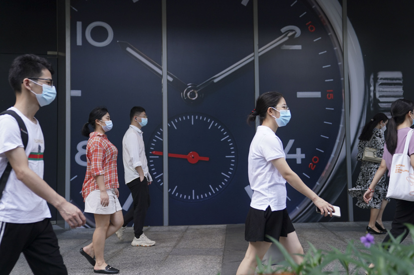 Young people walk in a commercial district of Shenzhen, Guangdong province, July 24, 2020. Su Dan/CNS/People Visual