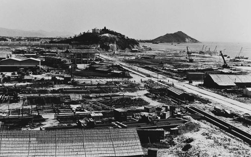 A view of the under-construction Shekou Industrial Zone in Shenzhen, Guangdong province, 1981. He Huangyou via Shenzhen Art Museum
