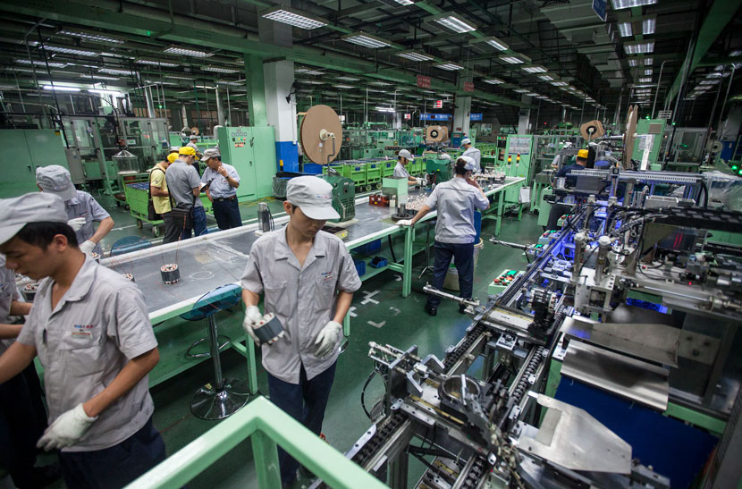 Workers on an automated production line in Shunde, Guangdong province, July 19, 2014. Zheng Junbin/People Visual