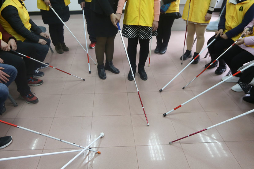 Students practice using canes at a Golden White Canes boot camp in Nanjing, Jiangsu province, 2018. Yang Bo/CNS/People Visual