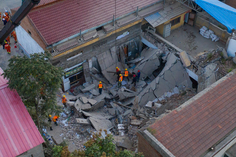 An aerial view of a rescue operation at a collapsed restaurant in Xiangfen County, Shanxi province, Aug. 29, 2020. Fifty-seven people had been pulled out of the debris of the collapsed two-story building, including 29 dead, seven severely injured, and 21 slightly injured. Wu Junjie/CNS/People Visual