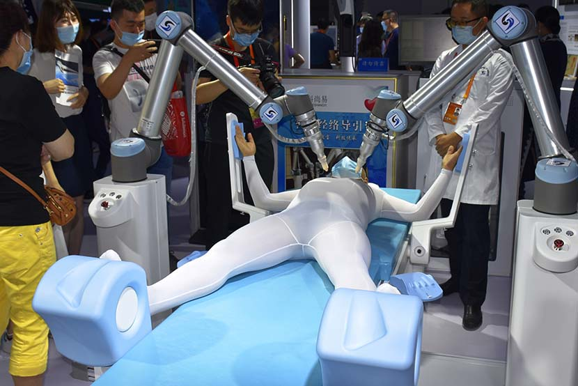 A manikin receives robot-administered acupuncture treatment during the China International Fair for Trade in Services (CIFTIS) in Beijing, Sept. 6, 2020. People Visual
