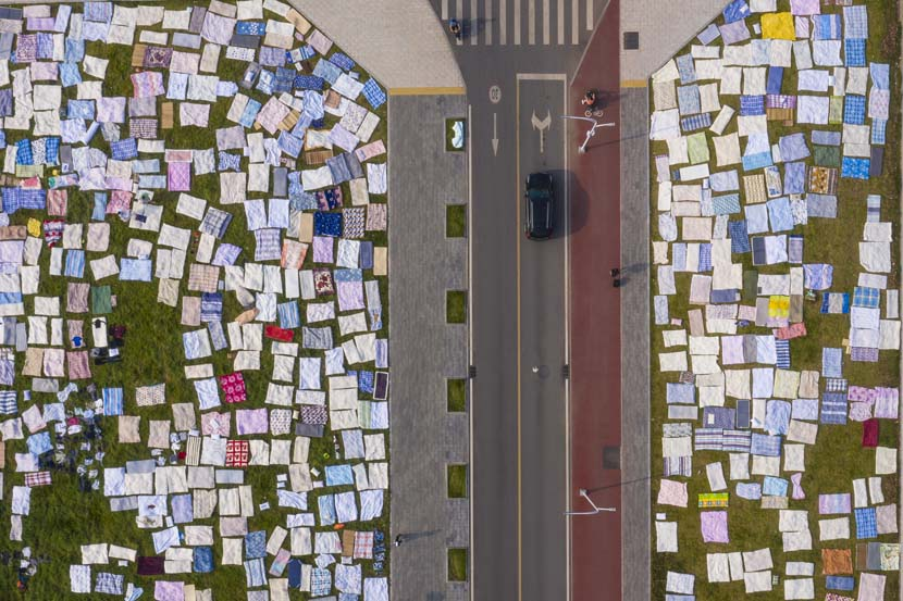 Quilts are laid out in the sun before classes start at Huazhong University of Science and Technology in Wuhan, Hubei province, Aug. 30, 2020. People Visual
