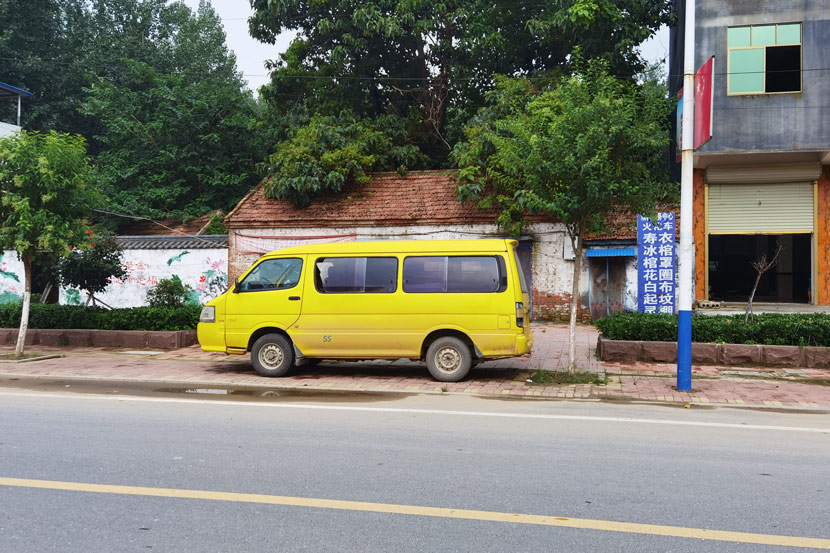 A crematorium van is parked on a roadside in Lizhuang Village, Shandong province, Aug. 6, 2020. Yuan Suwen for Sixth Tone