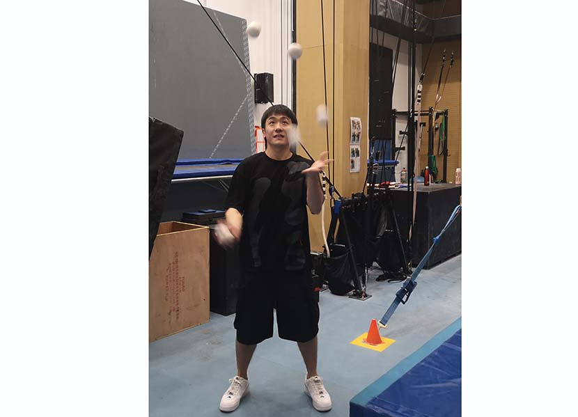 He Weiguo demonstrates his juggling skills backstage at the Xintiandi Group Sun Theater in Hangzhou, Zhejiang province, July 8, 2020.