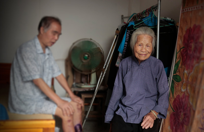 Qin Jiangming and his mother at their home in Longzhou County, Guangxi Zhuang Autonomous Region, Aug. 24, 2020. Li You/Sixth Tone