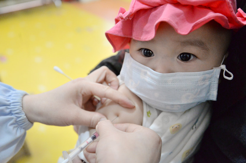 A baby receives a routine vaccination in Handan, Hebei province, April 25, 2020. Hao Qunying/People Visual
