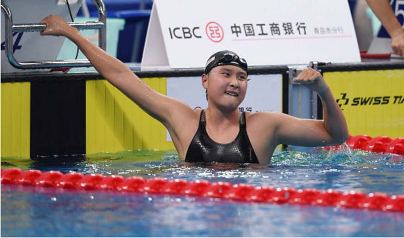 Wang Jianjiahe gives a fist pump after setting national and Asian records in the 1,500-meter freestyle event at the 2020 Chinese National Swimming Championships in Qingdao, Shandong province, Sept. 27, 2020. Tao Xiyi/Xinhua