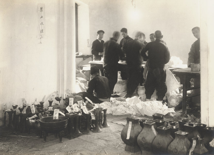 Palace Museum staff box up artifacts in the Forbidden City, Beijing, 1930s. Courtesy of the Palace Museum