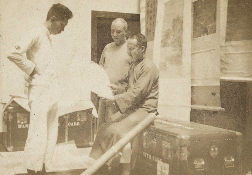 Palace Museum staff inspect part of the collection in Shanghai, 1930s. Courtesy of the Shanghai Library