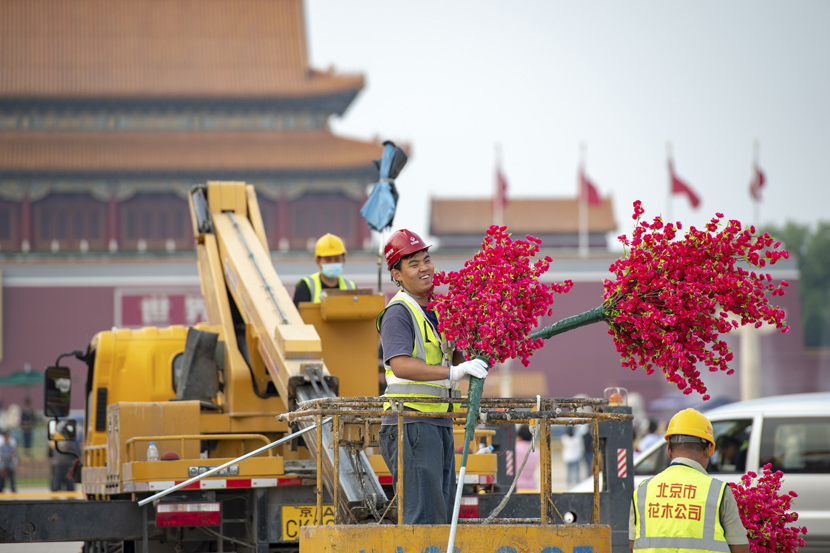 Workers arrange flower displays in Tiananmen Square prior to China's National Day holiday, Beijing, Sept. 21, 2020. Tian Yuhao/CNS/People Visual