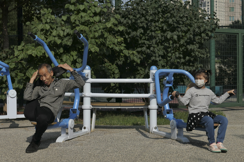 Residents try out some new fitness equipment at a park in Beijing, Sept. 25, 2020. Wei Tong/Beijing Youth Daily/People Visual