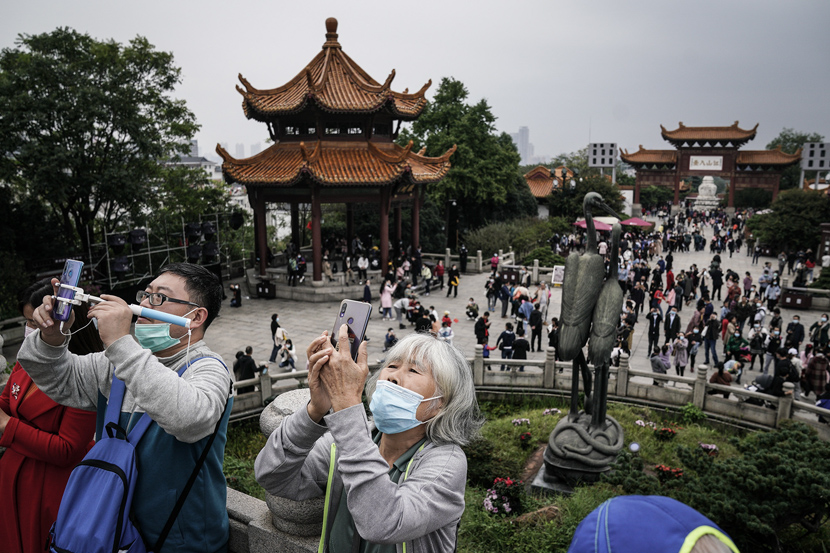 Visitors take in the sights at Yellow Crane Tower in Wuhan, Hubei province, Oct. 9, 2020. Zhang Muzhi/IC