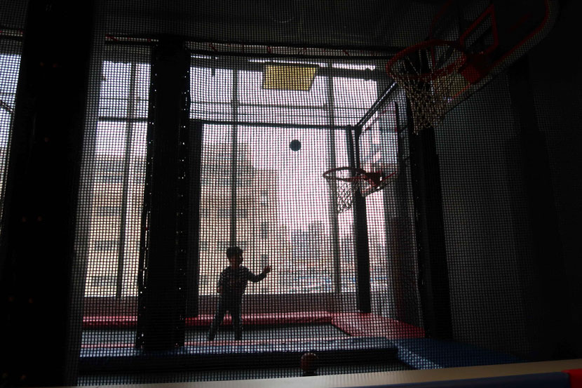 A child with autism plays basketball in Shanghai, March 31, 2019. People Visual