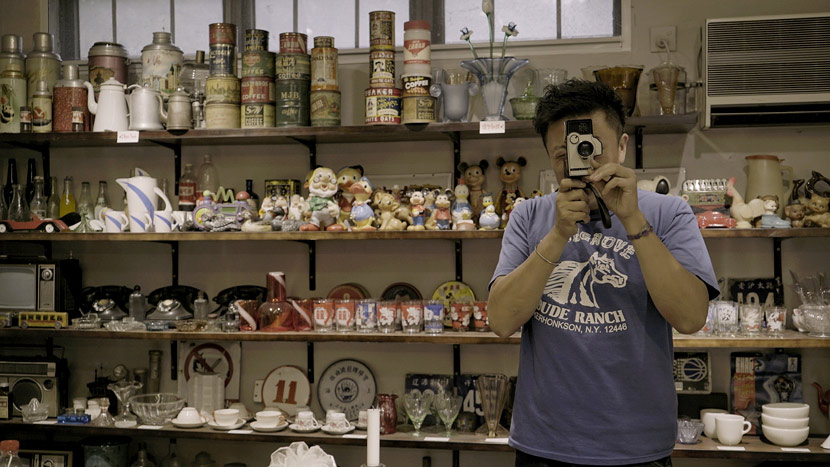 Dong Xiongfei poses for a photo with his collection of salvaged artifacts at his studio in Shanghai, September 2020. Du Xinyu/Sixth Tone