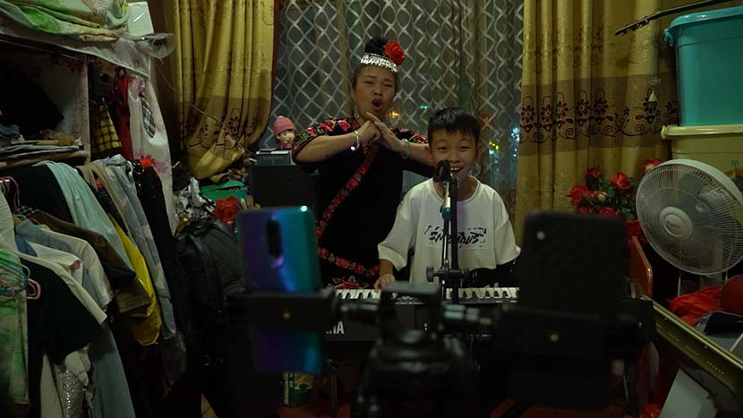 Shu Aohua livestreams at home with his mom. Courtesy of Sun Mengjun