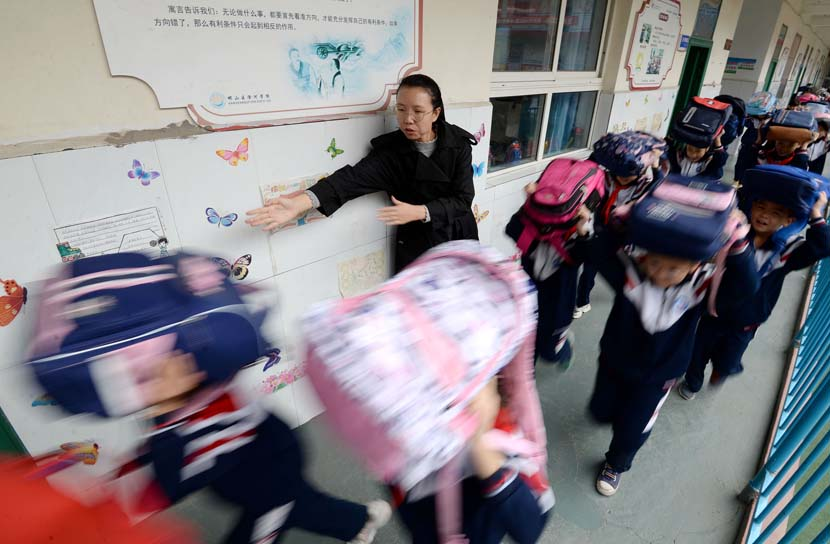 Students rush out of their classroom under their teacher's guidance during an earthquake drill in Handan, Hebei province, Oct. 12, 2020. People Visual
