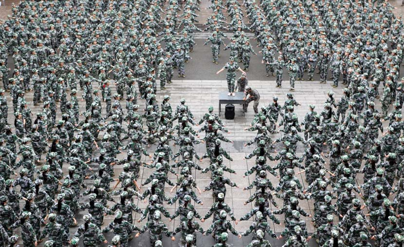 Freshmen receive military training at a college in Chongqing, Oct. 13, 2020. People Visual