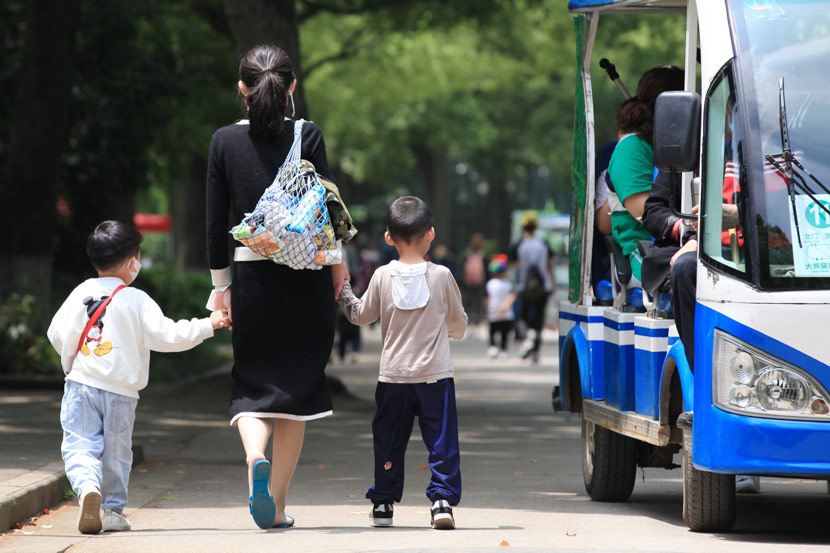 A mother takes her children to a park in Nanjing, Jiangsu province, May 10, 2020. Liu Jianhua/People Visual