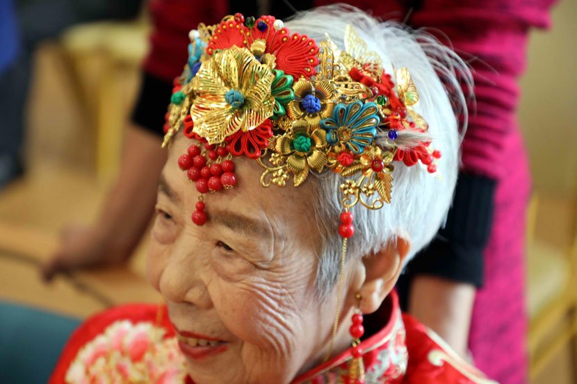 A well-dressed elderly woman prepares for a performance to celebrate the Double Ninth Festival, also known as Chongyang Festival, at a nursing home in Wuhu, Anhui province, Oct. 23, 2020. In modern times, the day has become a Senior Citizens' Festival, blessing them for good health. Li Qingsong/IC