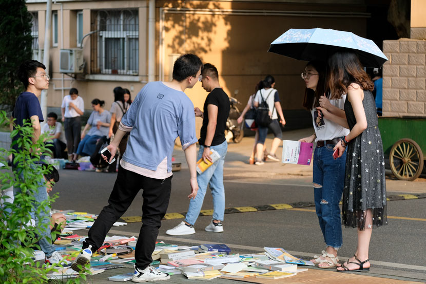 College students at a university flea market in Wuhan, Hubei province, June 10, 2019. People Visual