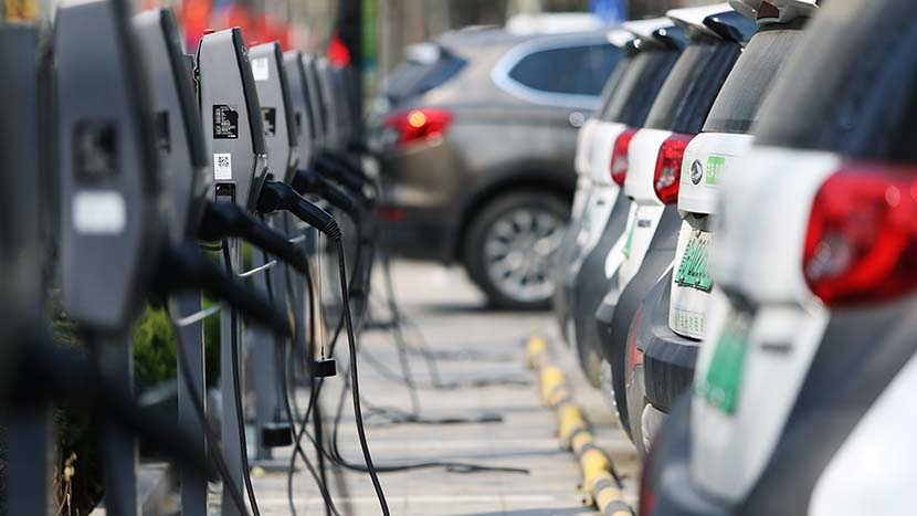Electric vehicle charging stations in a parking lot in Weifang, Shandong province, March 24, 2020. People Visual