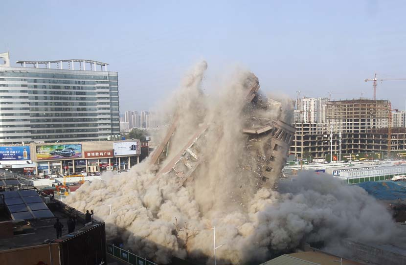 An old building is blasted in Zhengzhou, Henan province, Oct. 31, 2020. People Visual