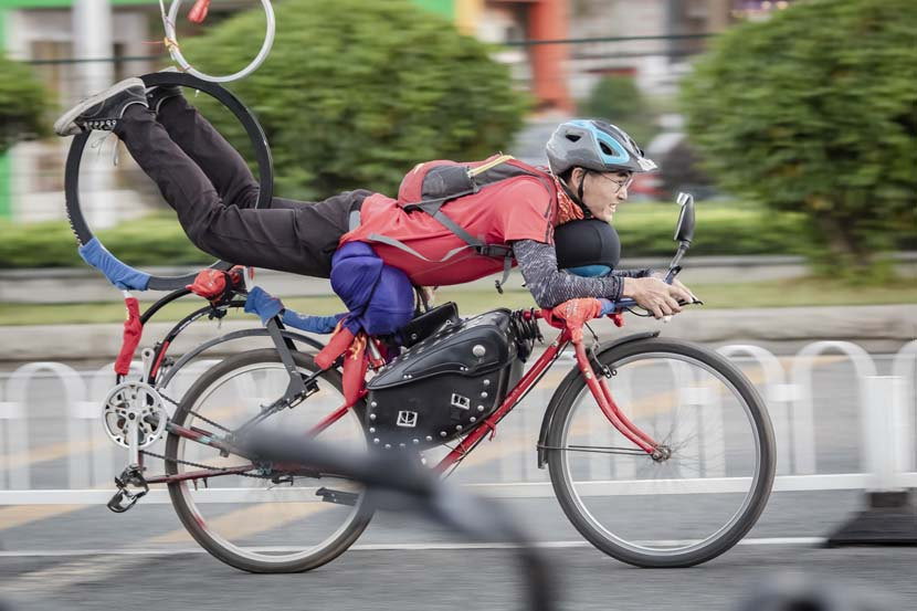 A delivery driver rides on his modified bicycle in Guangzhou, Guangdong province, Oct. 27, 2010. People Visual