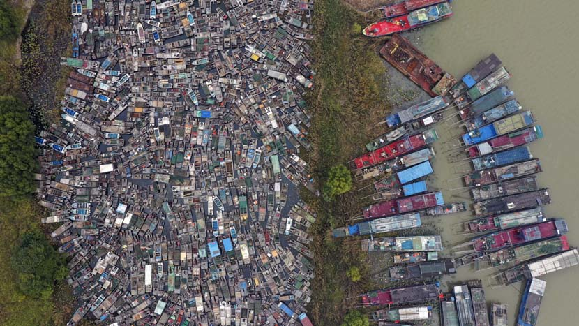An aerial view of fishing boats waiting to be disassembled in Huai'an, Jiangsu province, Nov. 1, 2020. Fishing activities have been prohibited in Hongze Lake since last month. Chen Liang/People Visual