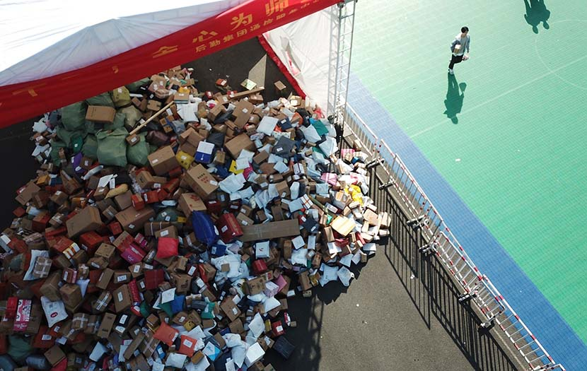 Packages are piled up beside a school playground at Zhejiang University in Hangzhou, Zhejiang province, Nov. 15, 2019. People Visual