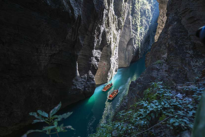 Tourists boat through a gorge in Enshi, Hubei province, Nov. 13, 2020. People Visual