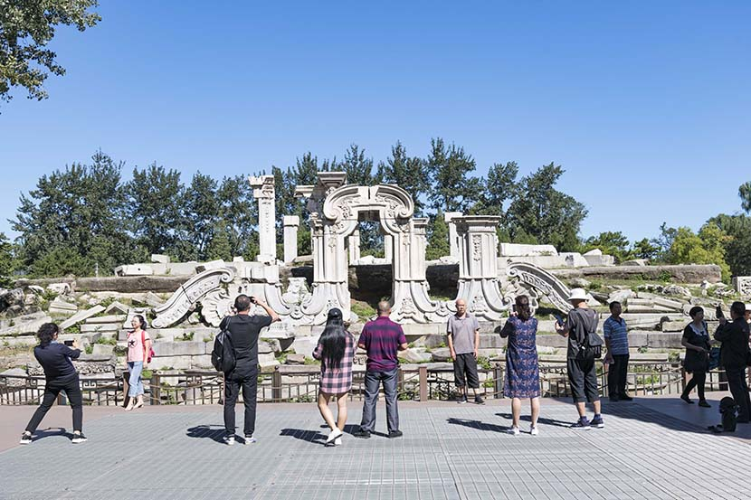 Tourists take photos at the Summer Palace in Beijing, Sept. 18, 2019. People Visual