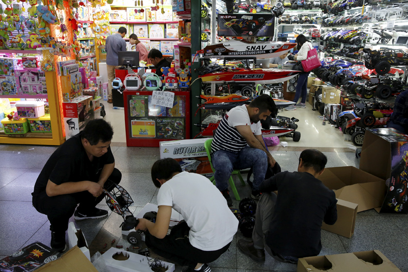 Buyers and vendors examine remote controlled toy cars at the wholesale market in Yiwu, Zhejiang province, April 28, 2017. Thomas Peter/Reuters via People Visual