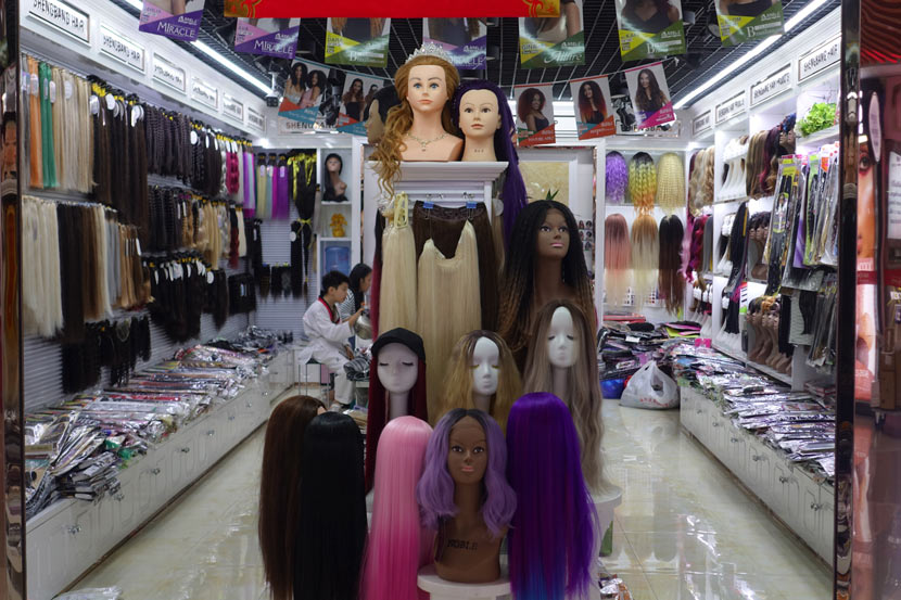 Wigs are displayed at a store in Yiwu, Zhejiang province, Oct. 17, 2020. Wu Peiyue for Sixth Tone