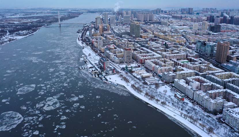 An aerial view of the Songhua River and the city of Harbin after heavy snowfall, Heilongjiang province, Nov. 21, 2020. People Visual