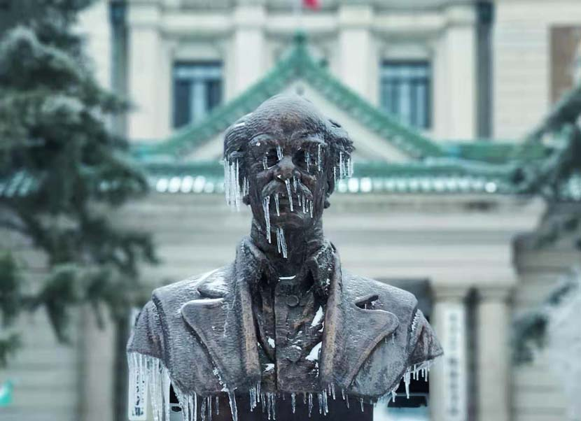 Icicles hang from a statue in Changchun, Jilin province, Nov. 19,  2020. IC