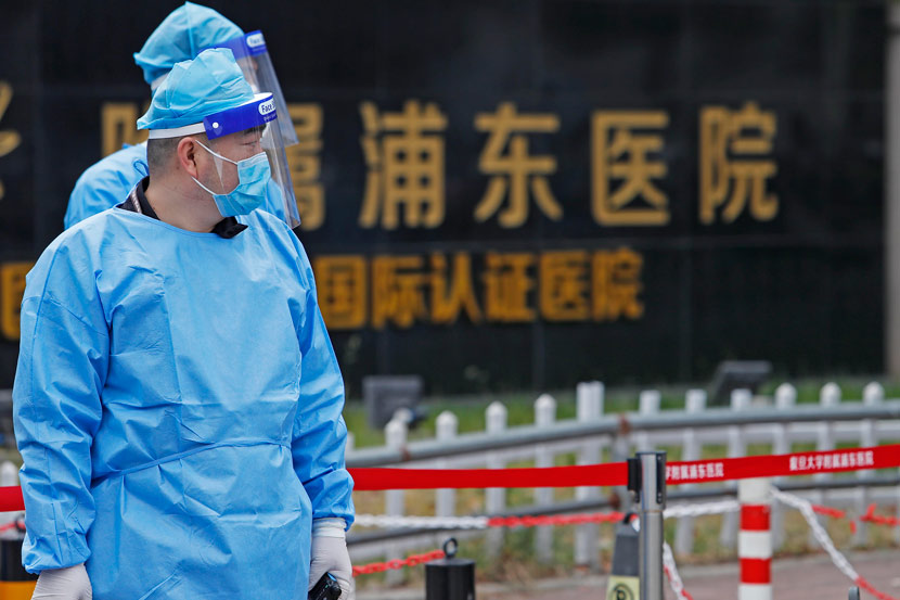 Medical staff wear personal protective equipment outside a hospital in Shanghai's Pudong New Area, Nov. 21, 2020. Three local COVID-19 cases have been confirmed in the city since Nov. 20. Yin Liqin/CNS/People Visual