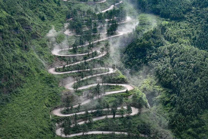 A view of the 24-turn road during a race in Qinglong County, Guizhou province, 2017. He Junyi/CNS/People Visual