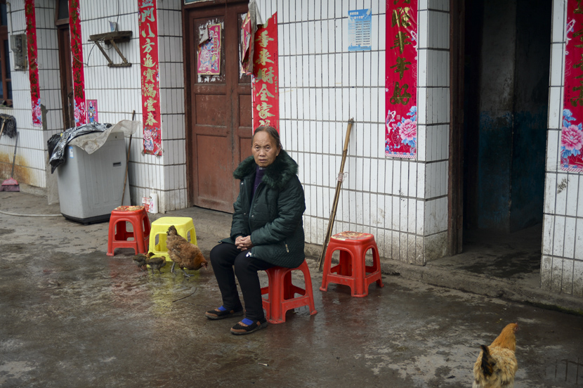 Dezliangz sits alone in front of her family's house in Qinglong County, Guizhou province, October 28, 2020. Stephen Che/Guyu