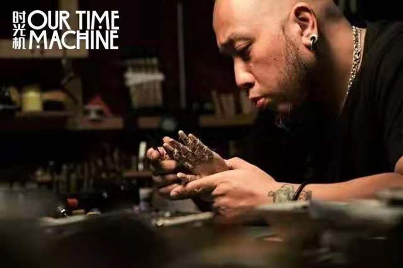 "A promotional poster for ""Our Time Machine"" shows Ma Liang tinkering on a project. Courtesy of Sun Yang"