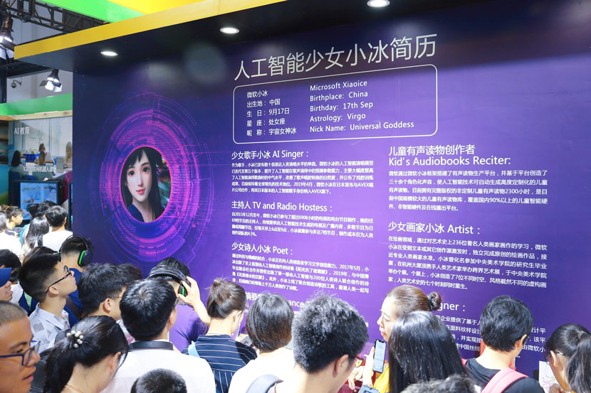 Visitors view the Xiaoice booth at the World Artificial Intelligence Conference 2019 in Shanghai, Aug. 31, 2019. Chen Yuyu/People Visual