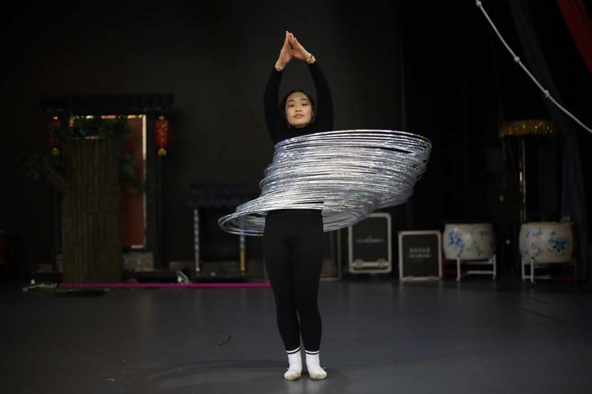 An acrobat practices hula hooping at an acrobatics school in Anqing, Anhui province, Dec. 9, 2020. People Visual