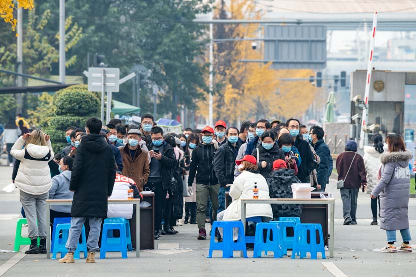 Residents line up to take nucleic acid tests at Southwest Jiaotong University in Chengdu, Sichuan province, Dec. 11, 2020. The city was on high alert after reporting new local COVID-19 cases. People Visual