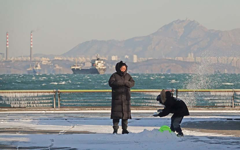 People play in the snow at the seaside in Dalian, Liaoning province, Dec. 13, 2020. People Visual