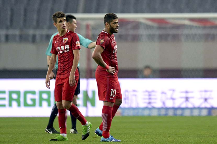 Brazilian soccer stars Oscar (left) and Hulk during a Chinese Super League match in Shanghai, April 21, 2017. At the time, they were two of the highest-paid players in the league. People Visual
