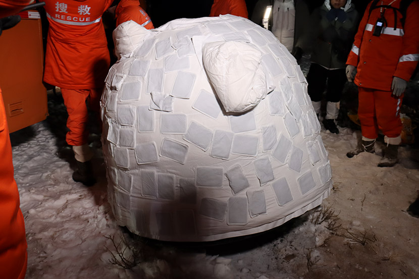 The Chang'e 5 return module after landing in the Inner Mongolia Autonomous Region, Dec. 17, 2020. The heating pads are to prevent any unspent fuel from freezing. Li Shuheng/China Space News via CNS