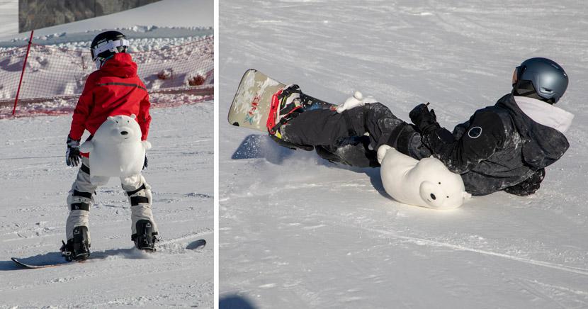 Snowboarders pad their bare bottoms with protective cushions shaped like polar bears in Jilin, Jilin province, Dec. 16, 2020. Zhu Wanchang/People Visual