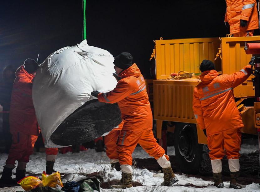 Workers move the Chang'e 5 return module, Inner Mongolia Autonomous Region, Dec. 17, 2020. Peng Yuan/Xinhua